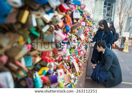 SEOUL - MAR 04,2015 : Love padlocks at N Seoul Tower or Locks of love is a custom in some cultures which symbolize their love will be locked forever at Seoul Tower in seoul,Korea. - stock photo