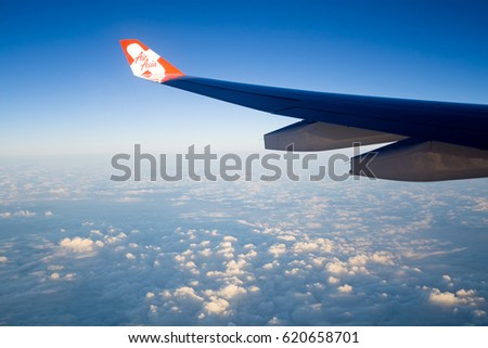 SEOUL, SOUTH KOREA - APRIL 05, 2017: AirAsia X airplane in flight with plane's wing logo flying to South Korea. AirAsia as Asia's Leading Low Cost Airline.