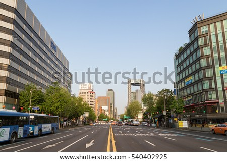 "SEOUL, SOUTH KOREA - APRIL 29, 2016: Light traffic on the Jongno (""Bell Street"") thoroughfare in the central Seoul, South Korea, viewed from the middle of the street."