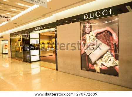 SEOUL,SOUTH KOREA - APRIL 14, 2015 : The GUCCI shop inside  Dongwha duty free Department store in Seoul. There are lots of fashion shops i.e. cloths, cosmetic, watch etc.  - stock photo