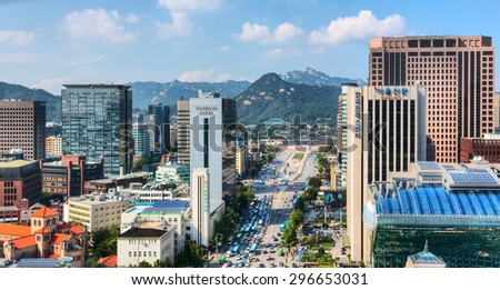"""SEOUL, SOUTH KOREA - 30 AUGUST 2013: Aerial view of Jongno-Gu business district, known as a """"Heart of Seoul"""". South Korea - stock photo"""