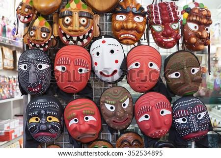 SEOUL, SOUTH KOREA - AUGUST 14, 2015: Korean wooden masks sold in Insadong street in Seoul, South Korea on AUGUST 14, 2015 - stock photo
