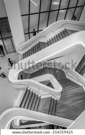 SEOUL, SOUTH KOREA - AUGUST 24: Modern architecture inside the Dongdaemun Design Plaza, designed by world renowned architect Zaha Hadid. Photo taken August 24, 2014 in Seoul, South Korea. - stock photo
