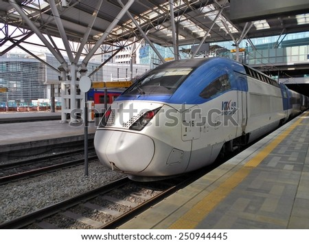 SEOUL, SOUTH KOREA -- CIRCA JANUARY 2015-- High-speed bullet trains (KTX) and Korail trains stop at the Seoul station in South Korea. - stock photo