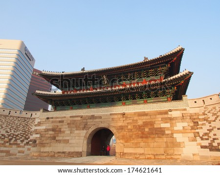 SEOUL, SOUTH KOREA - DEC 20: Namdaemun in Seoul, South Korea on December 20, 2013. Namdaemun, officially known as the Sungnyemun, is one of the Eight Gates in the Fortress Wall of Seoul, South Korea. - stock photo