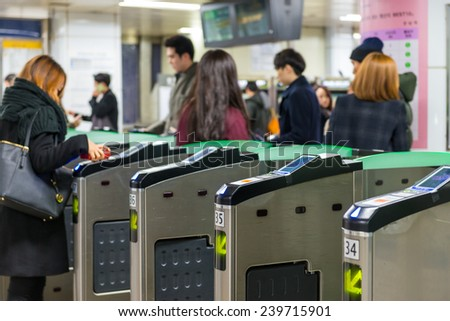 SEOUL, SOUTH KOREA - DECEMBER 21: Local Seoulites swipe their metro cards at Gangnam Station on December 21, 2014 in Seoul, South Korea. - stock photo
