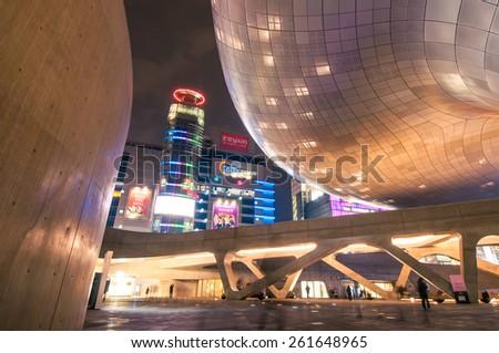 SEOUL, SOUTH KOREA - FEBRUARY 28, 2015 : Modern architecture of Dongdaemun Design Plaza at night, The building designed by Zaha Hadid and Samoo. - stock photo