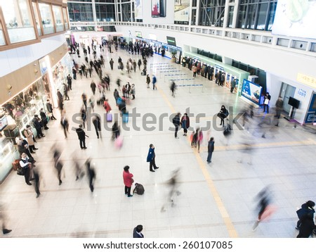 SEOUL, SOUTH KOREA - FEBRUARY 25, 2015 : Passengers inside of Seoul Station. The station is the terminus for the country's high-speed train KTX. - stock photo