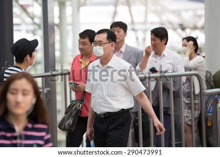 SEOUL, SOUTH KOREA - JUN 24, 2015: A tourist wearing a mask for protect from Mers virus in South  Korea, at Seoul station,Virus MERS, which has no known cure or vaccine.