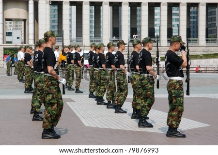 SEOUL, SOUTH KOREA - JUNE 08: Honor Guards from the marines perform a gun drill at the Korean War Memorial Museum on June 08, 2011 in Seoul, South Korea. South Korea is still technically at war with North Korea.