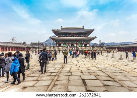 SEOUL, SOUTH KOREA - MARCH 08 : Early morning tourists start to flock at Gyeongbokgung palace on March 08,2014 in Seoul, Korea. It is the largest palace of the South Korea built by the Joseon Dynasty. - stock photo