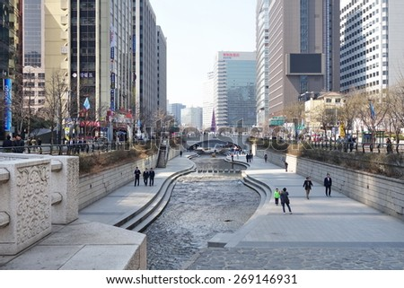 SEOUL, SOUTH KOREA - MARCH 25, 2015: People at Cheonggyecheon stream. The stream is a 10.9 km (7.0 miles) long, modern public recreation space in downtown Seoul, South Korea.