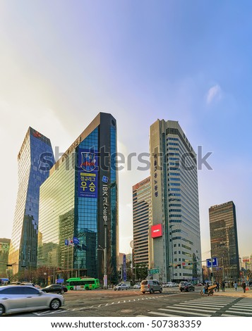 Seoul, South Korea - March 14, 2016: Skyscrapers and car traffic  in Jongno district of Seoul, South Korea. People on the background. Golden light at the sunset