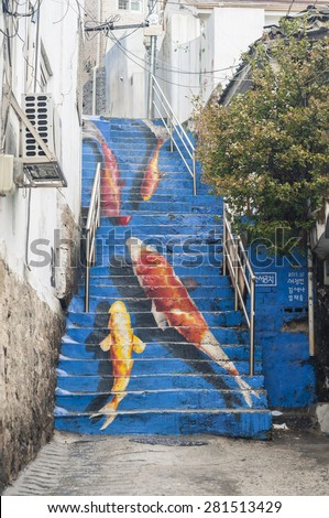 Seoul, South Korea - March 03, 2015 : The Koi stair in Ihwa Mural Village in 25 March 2015.  - stock photo