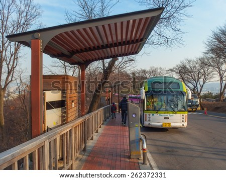 SEOUL, SOUTH KOREA - MARCH 7, 2015:  Traveler are down to the bus stop at Namsan Tower, also known as North Seoul Tower, is a famous landmark in Seoul, South Korea. March 07, 2014 in Seoul, South Korea. - stock photo