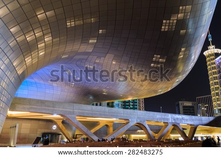 SEOUL, SOUTH KOREA - May 05: Modern architecture at the Dongdaemun Design Plaza at Night on May 05, 2015 in Seoul, South Korea.  - stock photo
