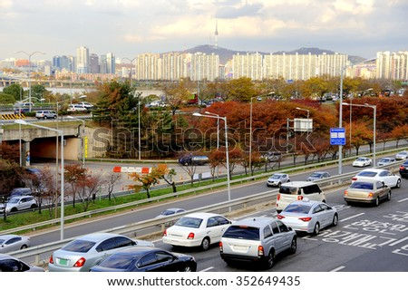 SEOUL, SOUTH KOREA-NOVEMBER 12: Traffic on highway leading to the city center. During rush hour highways and roads are full with traffic. At background Seoul Tower.November 12, 2015 Seoul,South Korea - stock photo