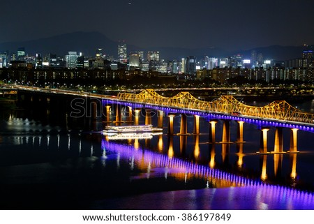 Seoul South Korea. October 2014. Dongho Bridge and cruise past the glittering below. Hangang River