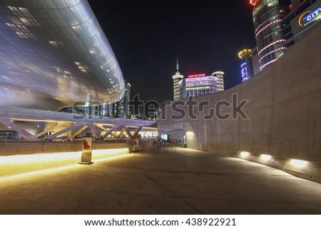SEOUL, SOUTH KOREA -  SEPTEMBER 27, 2015: Dongdaemun Design Plaza at Night, New development in Seoul, designed by Zaha Hadid. Photo taken september 27, 2015 in Seoul, South Korea. - stock photo