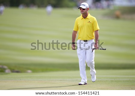 Sep 15, 2013; Lake Forest, IL, USA; Rory Sabbatini approaches the 18th green during the third round of the BMW Championship at Conway Farms Golf Club. - stock photo
