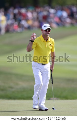Sep 15, 2013; Lake Forest, IL, USA; Rory Sabbatini waves to the crowd after putting the 18th green during the third round of the BMW Championship at Conway Farms Golf Club. - stock photo