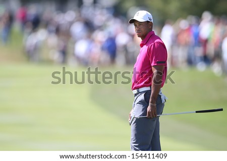 Sep 15, 2013; Lake Forest, IL, USA; Tiger Woods watches his putt on the second green during the third round of the BMW Championship at Conway Farms Golf Club. - stock photo