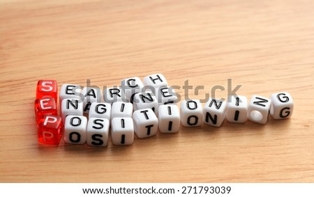 SEP   Search Engine Positioning written on cubes  on wooden surface