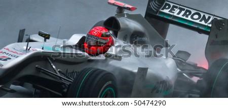 SEPANG F1 CIRCUIT, MALAYSIA - APR 3 : A closeup of Mercedes GP Petronas Formula One driver Michael Schumacher during qualifying on April 3, 2010 in Sepang F1 circuit outside Kuala Lumpur, Malaysia - stock photo