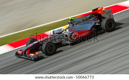 SEPANG F1 CIRCUIT, MALAYSIA - APR 2 : McLaren Mercedes Formula One driver Lewis Hamilton drives during the first practice session on April 2, 2010 in Sepang F1 circuit outside Kuala Lumpur, Malaysia - stock photo