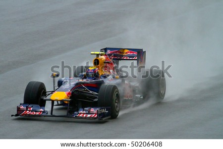 SEPANG F1 CIRCUIT, MALAYSIA - APR 3 : Red Bull Racing Formula One driver Mark Webber in action during qualifying  session on April 3, 2010 in Sepang F1 circuit outside Kuala Lumpur, Malaysia - stock photo