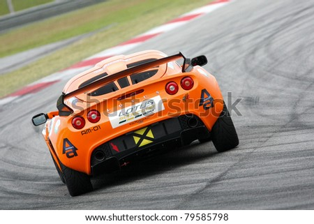 SEPANG - JUNE 17: Chew Ruoh Peng in a Lotus Exige S AM-01takes to the tracks of the Sepang International Circuit at the GT Asia Series race on June 17, 2011 in Sepang, Malaysia. - stock photo