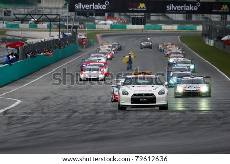 SEPANG - JUNE 19: GT cars start their warm-up lap of the Japan SUPER GT Round 3 race at the Sepang International Circuit on June 19, 2011 in Sepang, Malaysia. - stock photo