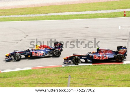 SEPANG, MALAYSIA-APR 8:Red Bull Racing's Sebastian Vettel and Mark Webber sees action on the first practice day of the Petronas Malaysian F1 Grand Prix on April 8, 2011 in Sepang, Malaysia. - stock photo