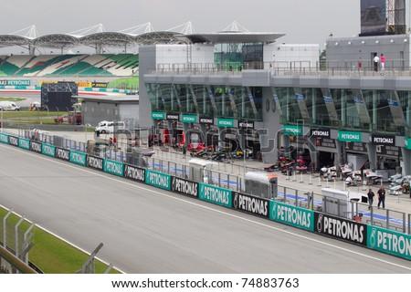 SEPANG, MALAYSIA - APRIL 8: A view of the pit lane and F1 teams during Friday practice at Petronas Formula 1 Grand Prix on April 8, 2011 in Sepang, Malaysia - stock photo