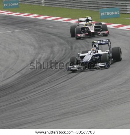 SEPANG, MALAYSIA - APRIL 2 : AT&T Williams driver Nico Hukenberg of German drives during Petronas Malaysian Grand Prix second practice session at Sepang F1 circuit April 2, 2010 in Sepang - stock photo