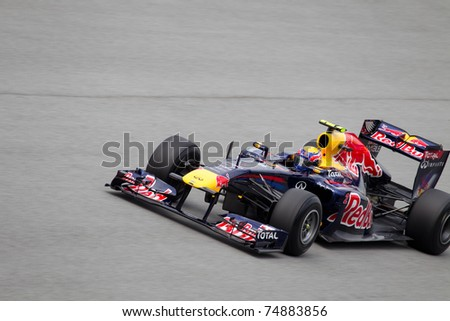 SEPANG, MALAYSIA - APRIL 8: Australian Mark Webber of Red Bull Racing at the back straight during Friday practice at Petronas Formula 1 Grand Prix on April 8, 2011 in Sepang, Malaysia - stock photo