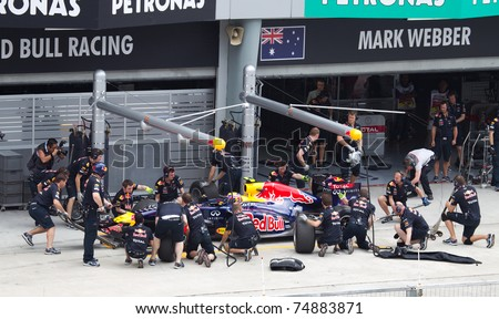 SEPANG, MALAYSIA - APRIL 8: Australian Mark Webber of Red Bull Racing having a trial pitstop during Friday practice at Petronas Formula 1 Grand Prix on April 8, 2011 in Sepang, Malaysia - stock photo