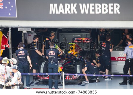 SEPANG, MALAYSIA - APRIL 8: Australian Mark Webber of Red Bull Racing waits to go out for Friday practice at Petronas Formula 1 Grand Prix on April 8, 2011 in Sepang, Malaysia - stock photo