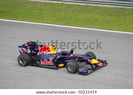 SEPANG, MALAYSIA - APRIL 4: Australian Mark Webber of Team Red Bull at top speed on the main straight at the Petronas Formula 1 Grand Prix April 4, 2010 in Sepang, Malaysia - stock photo