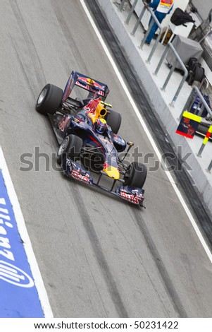 SEPANG, MALAYSIA - APRIL 4: Australian Mark Webber of Team Red Bull exiting the pit lane after a tyre change at the Petronas Formula 1 Grand Prix April 4, 2010 in Sepang, Malaysia - stock photo