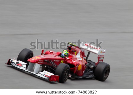 SEPANG, MALAYSIA - APRIL 8: Brazilian Felipe Massa of Scuderia Ferrari at the backstraight during Friday practice at Petronas Formula 1 Grand Prix on April 8, 2011 in Sepang, Malaysia - stock photo