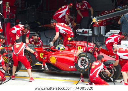 SEPANG, MALAYSIA - APRIL 8: Brazilian Felipe Massa of Scuderia Ferrari having a trial pitstop during Friday practice at Petronas Formula 1 Grand Prix on April 8, 2011 in Sepang, Malaysia - stock photo