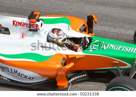 SEPANG, MALAYSIA - APRIL 4: Close up of German Adrian Sutil of Team Force India at the Petronas Formula 1 Grand Prix April 4, 2010 in Sepang, Malaysia - stock photo