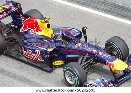 SEPANG, MALAYSIA - APRIL 4: Close up of German Sebastian Vettel of Team Red Bull accelerates at the back straight at the Petronas Formula 1 Grand Prix April 4, 2010 in Sepang, Malaysia - stock photo