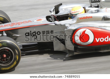 SEPANG, MALAYSIA - APRIL 8: Close-up of Lewis Hamilton of Vodafone McLaren Mercedes at PETRONAS Malaysian Grand Prix on April 8, 2011 in Sepang, Malaysia.The race will be held on Sunday April 10, 2011 - stock photo