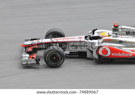 SEPANG, MALAYSIA- APRIL 8: Close-up of Lewis Hamilton of Vodafone McLaren Mercedes at PETRONAS Malaysian Grand Prix on April 8, 2011 in Sepang, Malaysia. The race will be held on Sunday April 10, 2011 - stock photo