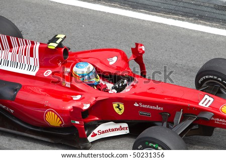 SEPANG, MALAYSIA - APRIL 4: Close up of Spanish Fernando Alonso of Team Ferrari at the Petronas Formula 1 Grand Prix April 4, 2010 in Sepang, Malaysia - stock photo