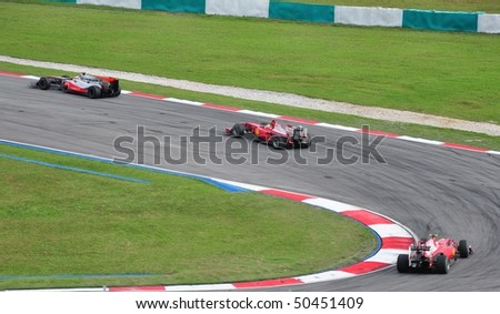SEPANG, MALAYSIA - APRIL 4: Drivers in battle for position during Petronas Malaysian Grand Prix  April 4, 2010 in Sepang, Malaysia - stock photo