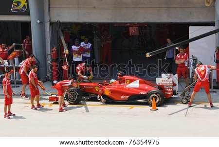 SEPANG, MALAYSIA - APRIL 8: Fernando Alonso (team Scuderia Ferrari Marlboro) on the pit at first practice on Formula 1 GP, April 8 2011, Sepang, Malaysia - stock photo