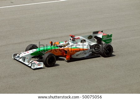 SEPANG, MALAYSIA - APRIL 2: German Adrian Sutil of Team Force India accelerates down the back straight at the Petronas Formula 1 Grand Prix April 2, 2010 in Sepang, Malaysia - stock photo